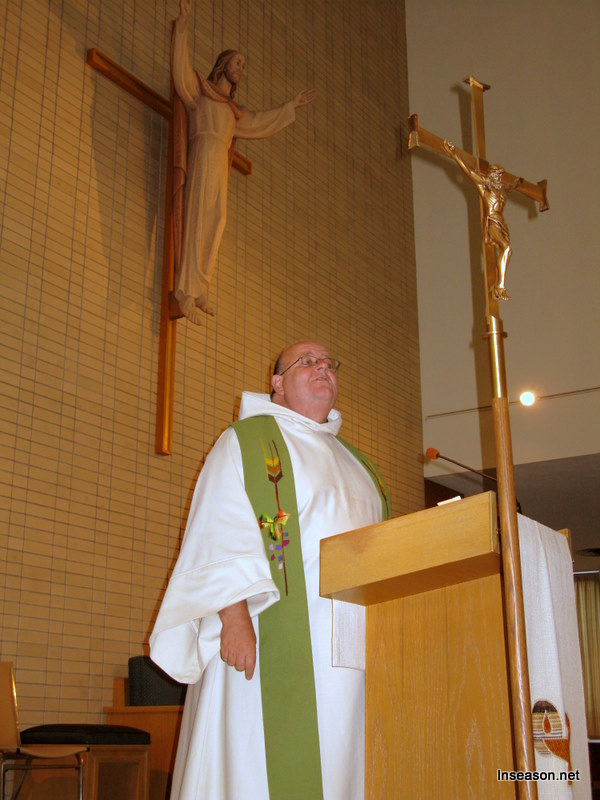 Fr. Tom preaching at the podium at the Espousal Center in Waltham, MA
